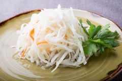 Salted and marinated cabbage sauerkraut salad. Served with parsley stock photography