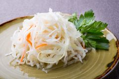 Salted and marinated cabbage sauerkraut salad. Served with parsley stock photos