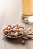 Salted mix cocktail nuts with beer and barley flower Royalty Free Stock Images