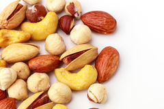 Salted nuts on white isolated background. Including almond, hazelnut, cashew nut and pistachio Royalty Free Stock Image