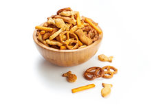 Salted party snacks. A pile of salted mixed party snacks background stock photo