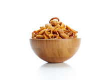 Salted party snacks. A pile of salted mixed party snacks background stock photography