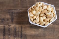 Salted peanut seeds - Arachis hypogaea. Salted peanut seeds on wooden background - Arachis hypogaea Royalty Free Stock Photography