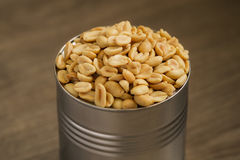Salted peanuts, nuts in a small metal bowl Stock Photos