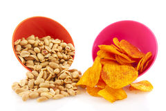 Salted peanuts and paprika chips Royalty Free Stock Images