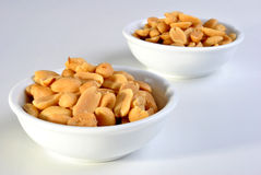 salted peanuts in a white bowl Royalty Free Stock Images