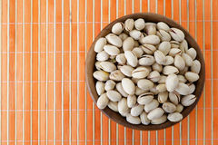 Salted peanuts in wooden bowl Stock Images
