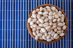 Salted peanuts in wooden bowl Royalty Free Stock Image