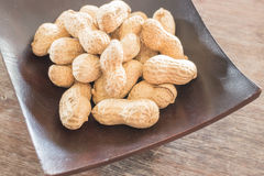 Salted peanuts on wooden bowl Royalty Free Stock Photography