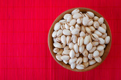 Salted peanuts in wooden bowl Stock Photo
