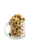 Salted pistachios in beer mug Stock Photos