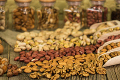 Salted pistachios in a glass jar, nut mix Stock Photo
