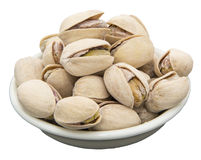 Salted pistachios nuts bowl isolated white Royalty Free Stock Photos