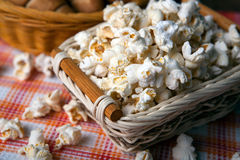 Salted popcorn in a wicker basket on a napkin. Close up royalty free stock images
