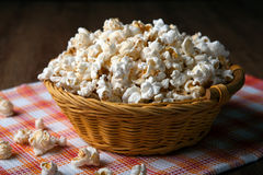 Salted popcorn in a wicker basket on a napkin. Close up royalty free stock photo