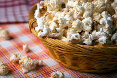 Salted popcorn in a wicker basket on a napkin. Close up royalty free stock image