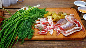 Salted pork lard salo with onion on a wooden board Royalty Free Stock Photography