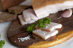 Salted pork lard (salo) on rye bread Royalty Free Stock Photos