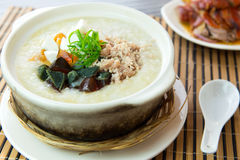 Salted and preserved egg chicken floss congee. Close up of salted and preserved egg chicken floss congee Stock Images