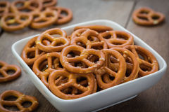 Salted pretzel in bowl Stock Photos