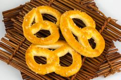 Salted pretzels in a bowl on wooden table cloths Royalty Free Stock Photography