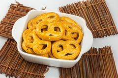 Salted pretzels in a bowl on wooden table cloths Stock Photography