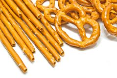 Salted pretzels and breadsticks closeup. Breadsticks and salted pretzels on white background Stock Image