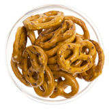 Salted pretzels in glass bowl isolated. On white background Stock Images