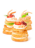 Salted puff pastry stuffed with cream cheese and prawns on white Stock Photography