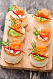 Salted  puff pastry stuffed with cream cheese and smoked salmon Stock Photography