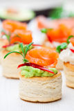 Salted  puff pastry stuffed with cream cheese and smoked salmon Stock Image