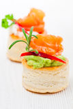 Salted  puff pastry stuffed with cream cheese and smoked salmon Royalty Free Stock Image