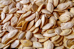 Salted Pumpkin Seed background - yellow texture Stock Images
