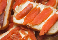 Salted red pieces of fish on a bread. delicacy food Royalty Free Stock Images