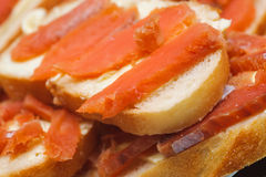 Salted red pieces of fish on a bread. delicacy food Royalty Free Stock Photo