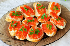 Salted red pieces of salmon on a bread Royalty Free Stock Images
