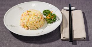Salted rice with vegetables and salmon, japanese cousine. Salted rice with vegetables and salmon, japanese fusion cousine on a grey tableclothn Stock Images