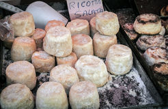 Salted Ricotta cheese on market stall Royalty Free Stock Photos