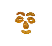 Salted and roasted Cashews nuts is snack.Isolate. Cartoon face Royalty Free Stock Photography