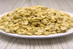 Salted roasted peanuts in a wooden bowl . stock images
