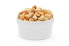 Salted and roasted pistachio nuts in a bowl Royalty Free Stock Image