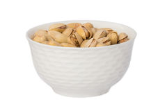 Salted and roasted pistachio nuts in bowl Stock Images