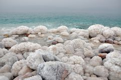 Salted rocks. Dead sea coast at Israel side Royalty Free Stock Photography
