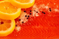 Salted salmon background. Salted salmon with lemon and pepper closeup Stock Photo