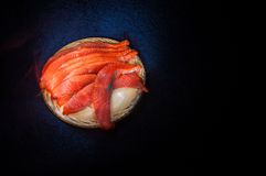 Salted salmon on clay saucer Royalty Free Stock Photo