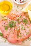 Salted salmon with dill on a wooden board, close-up, top view. Vertical Stock Images