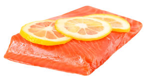 Salted salmon fillet and lemon slices. Isolated on white background Stock Photography