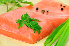 Salted salmon fillet, parsley and green onion Royalty Free Stock Photo