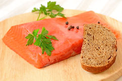 Salted salmon fillet, parsley and slice of bread Royalty Free Stock Photos