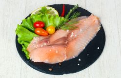 Salted salmon fillet. With spices stock photography
